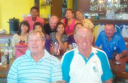 Barry Chadbourn & Capt' Bob relax after their win in the Songkran scramble on Tuesday.  In the background are some of the caddies with Sel Wegner and Geoff Moodie.