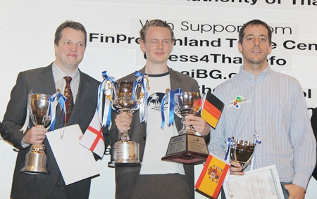 Jan Gustafsson of Germany, center, stands with runners up Nigel Short  of England, left, and Spain's Paco Vallejo at the conclusion of the 2011 Thai Chess Open tournament held at the Dusit Thani Pattaya Resort.