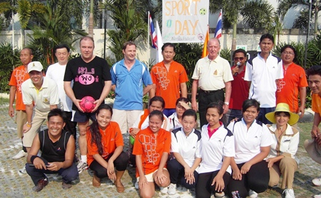 The Thai Garden Resort management players prepare to take on the female staff team at football.