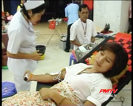A Nurse takes blood from a kind hearted donor