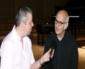 Ludovico Einaudi, right, talks to Paul Strachan during an interview for Pattaya Mail Television.