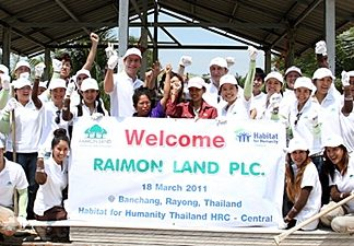 The Raimon Land team poses for a photo at the Ban Chang building site.