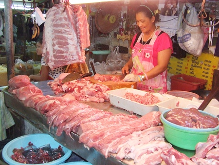 Saibua Hatyoung, a pork vendor at South Pattaya's Wat Chaimongkol Market, says prices are higher than she's seen in a decade and, as a result, her business is off 50 percent.