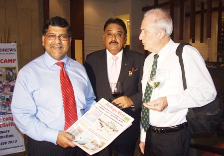 A must read, HE Asif Ahmad holds a copy of the Pattaya Mail as introduced to him by Peter Malhotra and Dr. Iain Corness.