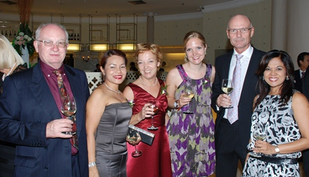 (L to R) Geoffrey Robinson; Suphaporn Robinson; Anja Schoof & daughter; Hans Schoof; and Chitra Chandrasiri are all smiles during the anniversary event.