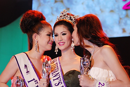 "First runner-up Saranrat ""Nat"" Chaiyakorn (left) and second runner-up Tisnamadee ""Giji"" Bunniyom (right) congratulate Miss Tiffany Universe 2011 Sirapasson ""Sammy"" Atthayakorn, a third year student at the Faculty of Humanities, Ramkhamhaeng University.  The Thailand qualifying event for the Miss International Queen pageant to be held later in the year took place last week, with the finals on Friday night, May 6."