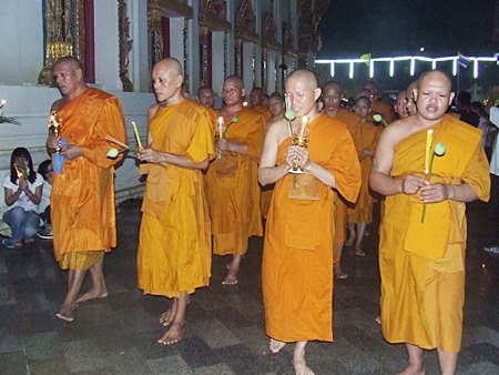 """Monks lead the Wien Thien ceremony around Wat Chaimongkol last Tuesday for Visakha Bucha Day.  Visakha Bucha Day is one of the three holiest days on the Buddhist calendar and this year was designated by UNESCO as """"World Peace Day."""""""