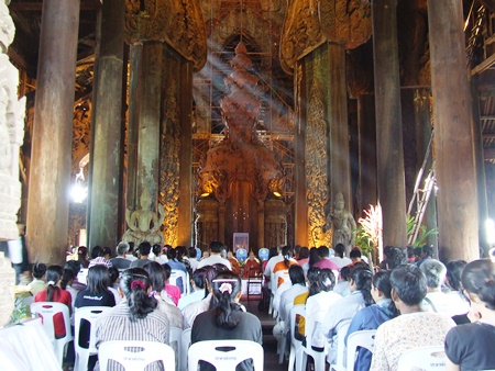 Buddhists and guests gather for religious ceremonies marking Visakha Bucha Day at the Sanctuary of Truth.