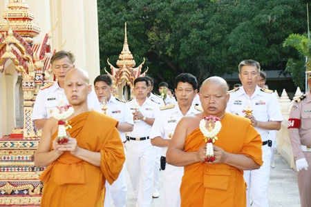 Revered monks lead officers and enlisted men around the temple at the Sattahip Naval Base.
