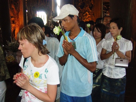 People perform the Wien Thien at the Sanctuary of Truth.