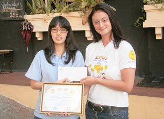 Jenjira Yossomsakdi (left), president of the I.S.E. High School Student Council donates the school's Silver Sponsorship and receives a certificate of appreciation from Deborah Philbrook representing Jesters Care for Kids 2011.