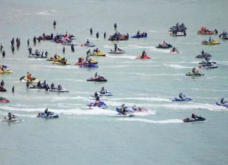 Some of the 84 adventurous jet ski riders prepare to set out across the Gulf of Thailand.