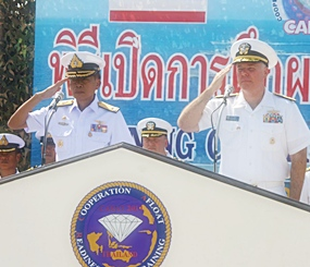 Adm. Chaiyos Sunthornnak (left), director of the Thai CARAT forces and chief of Frigate Squadron 2, and Rear Adm. Thomas Carney, commander of Task Force 73 preside over the CARAT opening ceremonies.