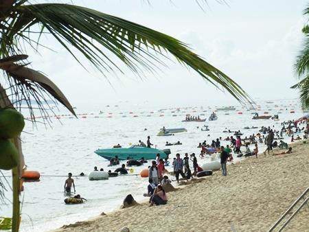 Tourists flock to the beaches over the long Labor Day weekend.