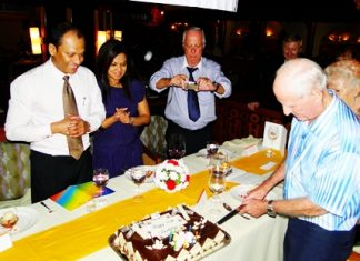 Richard Smith cuts his birthday cake.