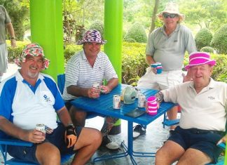 From the left: John, Jack, Chad & Geoff sporting their hats, knitted by the caddies, at Pattaya Country Club, Tuesday, May 17.