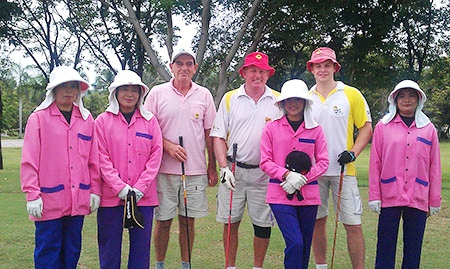 Kevin Fitzgerald with playing partners Capt' Bob and Harry Moseley (right) and caddies at Burapha on Monday, April 25.