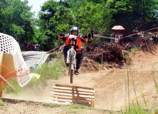 A rider flies over a ramp on the downhill course.