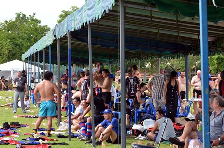 Players and spectators take some welcome shelter from the hot sun.