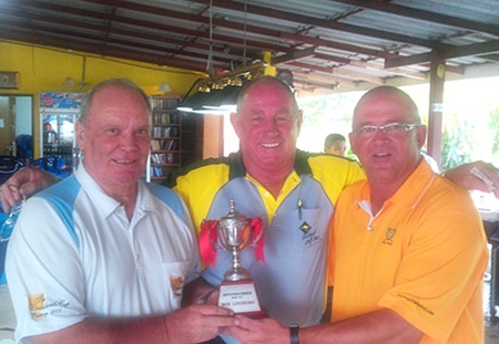 Bob Lindborg presents his birthday trophy to Capt's Bob and Brad.