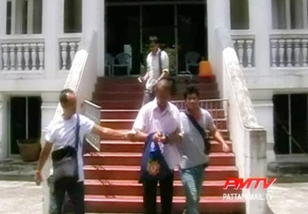 Once disrobed the ex monk  is escorted to the police station.
