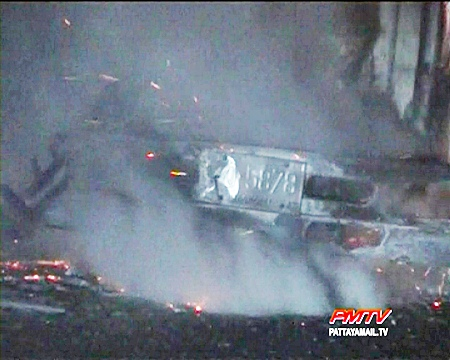 The smoldering remains of the truck