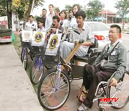 Four needy residents receive the new wheelchairs