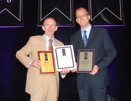 Stuart Shield, left, Chairman of the International Hotel Awards and Harald Feurstein,  right, General Manager of Hilton Pattaya, hold up the awards presented to the hotel at the Asia Pacific Hotel Awards 2011 ceremony at the Longemont Hotel, Shanghai, May 31.