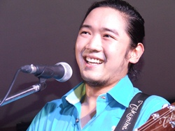 Aswin Duriyangkul 'Win' is all smiles as the band strum out another of their hit songs.