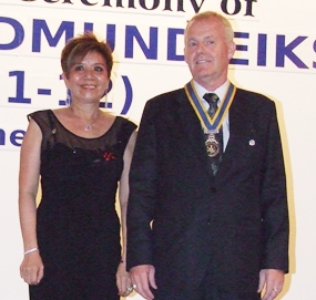 President Gudmund Eiksund stands proudly with his first lady Linda.