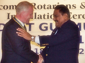 PDG Peter Malhotra congratulates President Gudmund Eieksund after installing him as President of the Rotary Club of Jomtien-Pattaya.