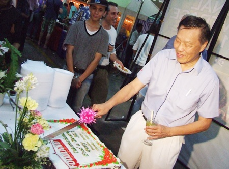 Edwin Lim cuts the colourful cake declaring the festival open.