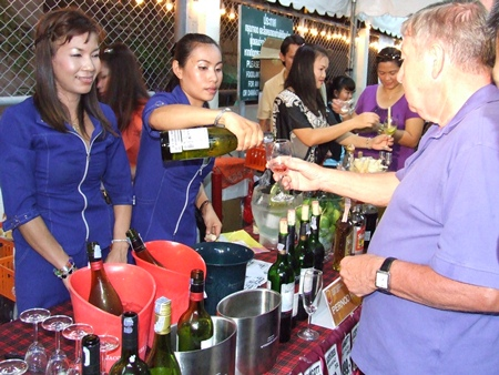 Guests milled about tasting fine foods and wines imported from all corners of the world