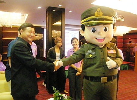 """Chonburi Immigration's """"Yim Yim"""" (smile) mascot is introduced at the opening ceremony for Immigration's new service minded campaign."""