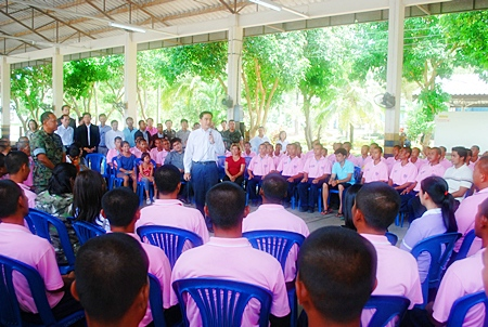 Prime Minister Abhisit Vejjajiva holds a talk with people at Wiwat Polamuang School.