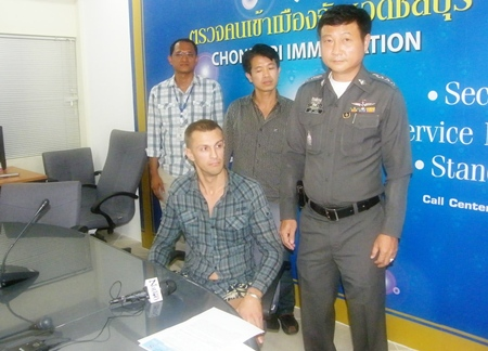 Chonburi Immigration Police have arrested Andrey Kozlov (seated) on a request from a Vladimir, Russia court.