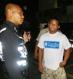 """Real"""" cops move in and arrest Chaisit Chaisae for impersonating an officer."""
