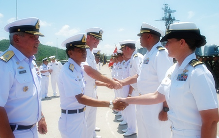 Royal Thai Navy Vice Adm. Surachai Sungkhapong greets U.S. Navy officers during the CARAT 2011 closing ceremony.