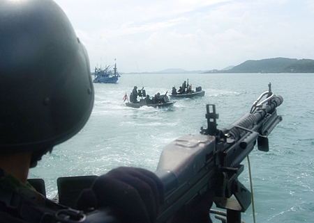 A Royal Thai Navy sailor monitors a target during a riverine exercise in the Sattahip Harbor Basin. (U.S. Navy photo by Mass Communication Specialist 3rd Class Christopher S. Johnson)