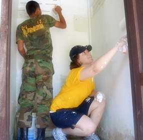 Ban Chang (May 12, 2011) - Operations Specialist Seaman Laura Jackson, attached to USS Tortuga (LSD 46), and a Royal Thai navy sailor, paint the inside of a bathroom at the Somboon Ranaram School during a joint community service project. (U.S. Navy photo by Mass Communication Specialist 1st Class Jose Lopez, Jr.)