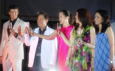 Stephane Bringer (left), general manager joined the Phanthusak family (l-r) Sutham, Alisa, Lalida and Varassaya in a toast to officially launch the Woodland Suites in 2009.