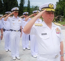 After laying a wreath to pay respect to Thai marines who died during service, Adm. Masahiko Sugimoto salutes active-duty personnel for their support after the March 11 earthquake.