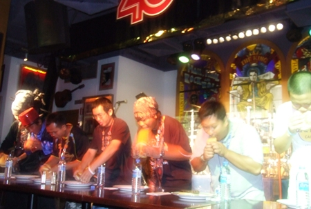Contestants pig out in the amusing burger eating competition.