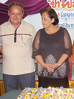 Pa Prem and his lovely wife Supanee prepare to blow out the candles on Prem's birthday kanome.
