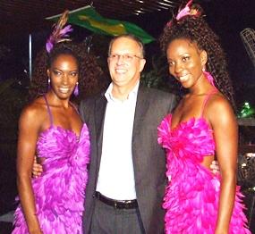 Brazilian Ambassador HE Paulo Cesar Meira de Vasconcellos poses with samba dancers at Zico's Brazilian Grill and Bar.