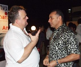 Engrossed in conversation: (from left) Michael Procher and H.E. Nabil H. Ashri.