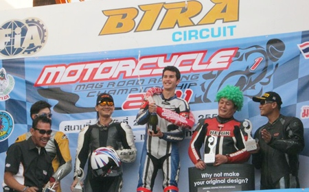 Ben Fortt, centre, celebrates his win in the 1000cc superbike rookie class event at Bira Circuit, Sunday, May 29.