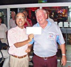 Low Gross winner Mashi Kaneta, left, with the PSC Golf Chairman Joe Mooneyham.
