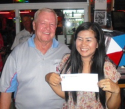 Noi Emmerson, right, proudly shows her prize for winning the Ladies Flight.