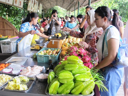 Buying fresh fruits and vegetables directly from the farmers.